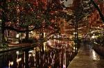san-antonio-riverwalk-decorated-with-shiny-lights-at-night-refle-alan-tonnesen